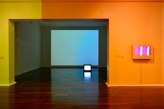 First Amongst Equals II, Perth Institute of Contemporary Arts, exhibition view. (L) Elizabeth McAlpine, Light Reading (Californian Sunset), 2007. (R) Len Lye, A Colour Box, 1935. Photo by Tony Nathan
